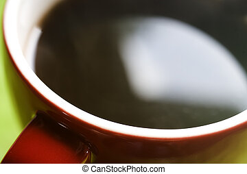 Red Coffee Cup on Green Background