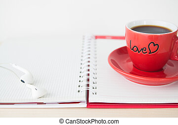 Red coffee cup on notebook, Valentine's Day