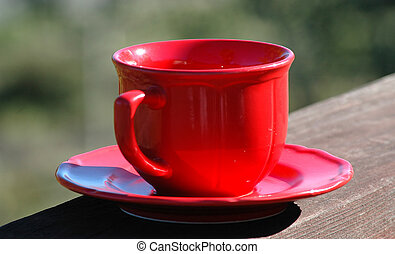 Red Coffee Cup - Photo of a red coffee cup sitting on a...