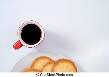 red coffee cup with cookies on background