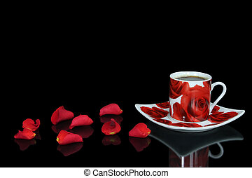 Red coffee cup with rose petals