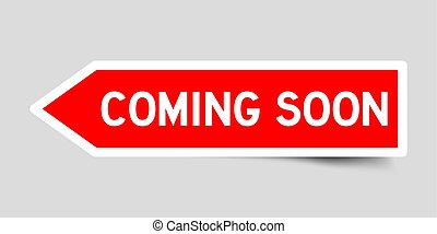 Red color arrow sticker with word coming soon on gray background