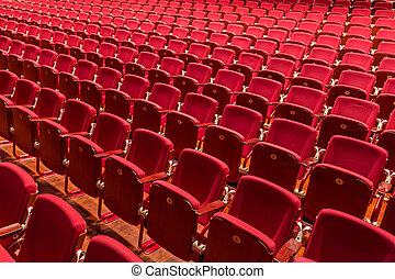 Red color theatre chair in conference room.