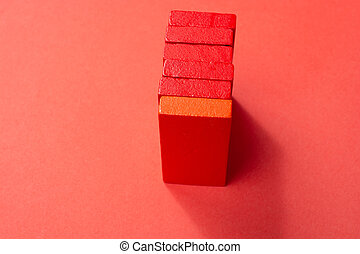 Red Color wooden building blocks domino pieces