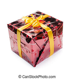 Red colored gift box with yellow ribbon isolated