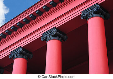 red columns on the facade in the old architectural building
