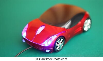 computer mouse in form of automobile glows blue backlight and rotates on rotating stand