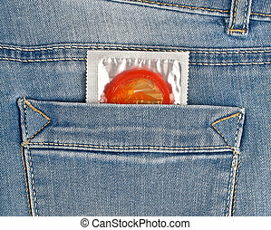 Red condom in blue jeans pocket