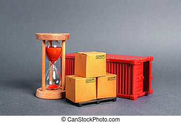 Red container with cardboard boxes and an hourglass. Express delivery in short time concept. Temporary storage, limited offer and discount. Optimization of delivery logistics Transport company