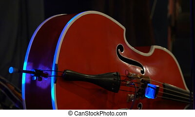 red contrabass on stage, detail close up