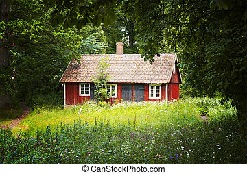 Red cottage - Image of a small red cottage in a forrest ...