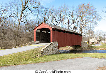 Red Covered Bridge - A red covered bridge from the side on a...