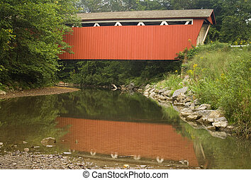 Red Covered Bridge Over a Stream - The red Everett Covered...