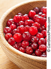 Red cranberries in wooden dish