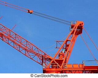 Red crane over blue sky