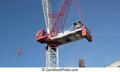 Red crane timelapse. - Red tower crane at construction site....