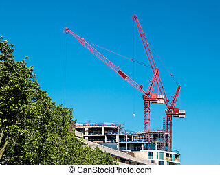 Red cranes in London