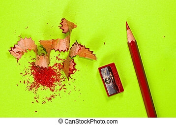 Red crayon on green background