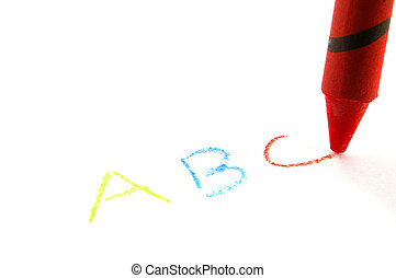 Red crayon writing abc, isolated on white