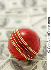 Red Cricket Ball and Money