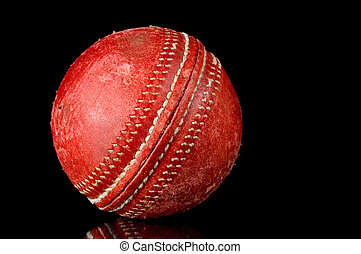 Red Cricket ball on black background