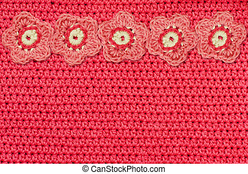 Red crochet fabric and handmade flowers