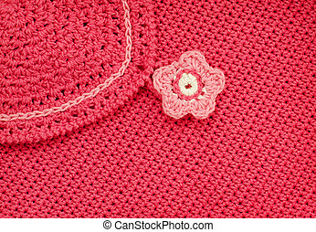 Red crochet fabric with flower button