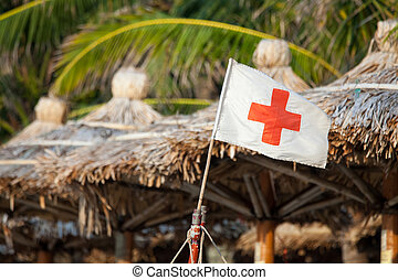 Red cross flag at the beach