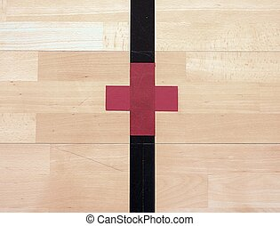 Red cross, playground corner. Worn out wooden floor
