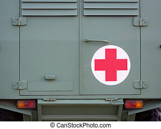 Red cross sign on military vehicle close up shot