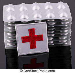 Red Cross - A Red Cross with tablet packaging