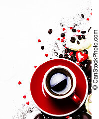 Red cup of espresso coffee on Valentine's day, sweets and pink petals, white background, top view