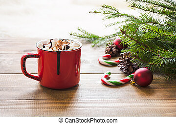 Red cup of hot chocolate with marshmallow on windowsill. Weekend concept. Home style. Christmas morning.