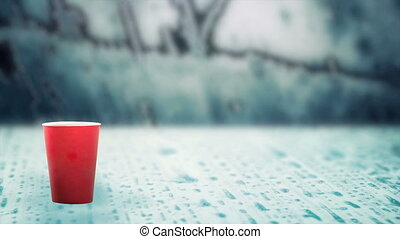 hot drink evaporating smoke on frozen ice - red cup of hot ...