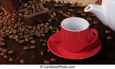 Red cup on saucer with hot black coffee espresso. Studio