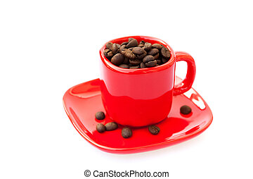 red cup with coffee beans isolated on white