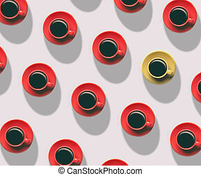 Red cups of coffee in a row and one yellow