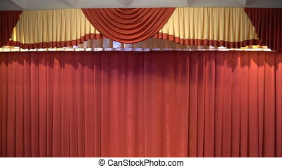 red curtain on stage in the theater. Curtains.