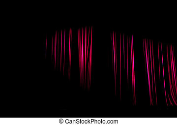 Red curtains with the darkness that still have light shining.