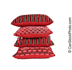 Red cushions stacked up on a white background with space for text