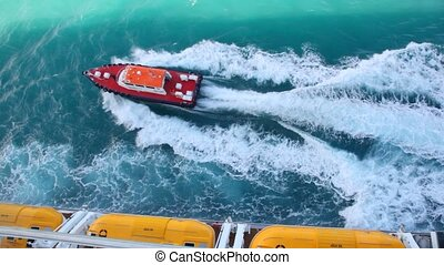 cutter sailing out cruise liner in sea