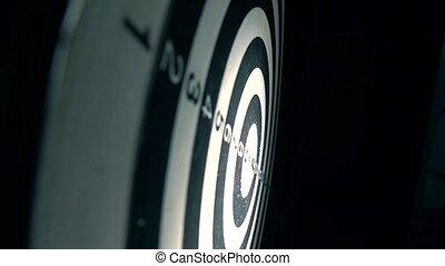 Red dart hits bull's eye of circular target. Success concept