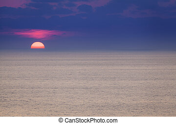 Red dawn over deep blue see
