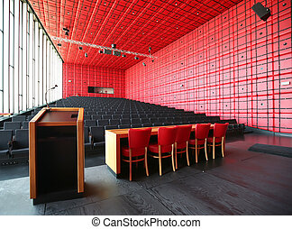 conference hall - red decorated interior for conference hall