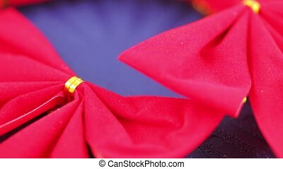 Red decorative bow - On a blue background a group of red...