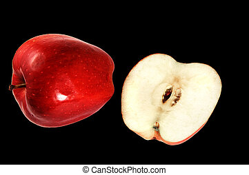 Red Delicious apples on black