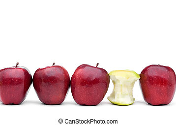 Red apples lined up on a white background with a single eaten green apple