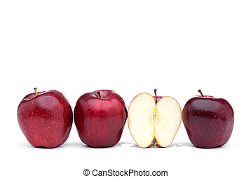 Red delicious apples with one sliced apple