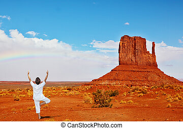 Red Desert and woman in white - Navajo Reservation in the...