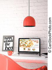 red desktop with laptop showing pizza order online website